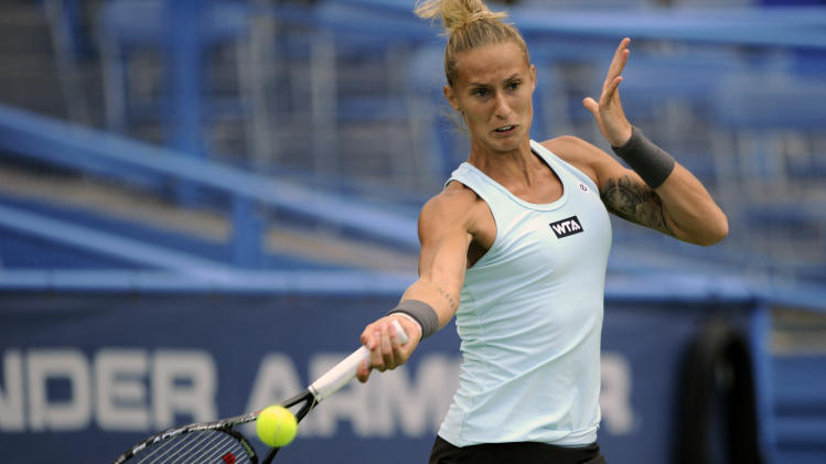 Polona Hercog, of Slovenia, returns the ball to Svetlana Kuznetsova, of Russia, during a match in the Citi Open tennis tournament, Monday, July 28, 2014, in Washington. (AP Photo/Nick Wass)