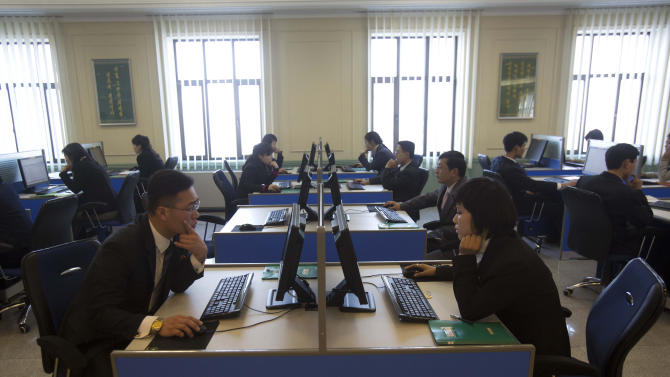 FILE - In this Jan. 8, 2013 file photo, North Korean students surf the internet at computer terminals inside a computer lab at Kim Il Sung University in Pyongyang, North Korea  during a tour by Executive Chairman of Google, Eric Schmidt. North Korea on Friday, March 15, 2013,  blamed South Korea and the United States for cyberattacks that temporarily shut down websites this week at a time of elevated tensions over the North's nuclear ambitions. Experts, however, indicated it could take months to determine what happened and one analyst suggested more likely culprits: hackers in China.  (AP Photo/David Guttenfelder, File)