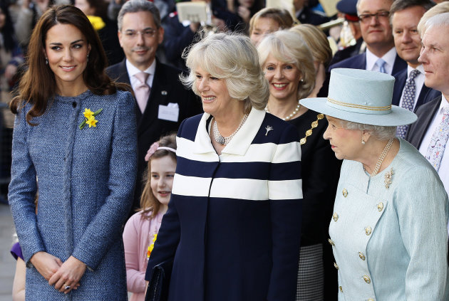 Britain&#39;s Queen Elizabeth II, right, Camilla, Duchess of Cornwall, centre, and Kate, Duchess of Cambridge stand outside the Fortnum and Mason department store for a ceremony to unveil a plaque to commemorate the regeneration of Piccadilly in central London, Thursday, March, 1, 2012. (AP Photo/Alastair Grant)