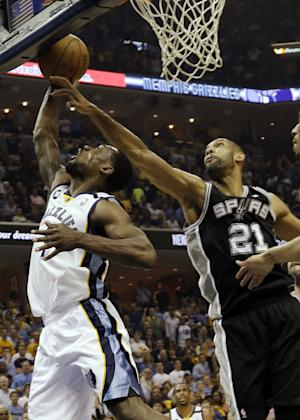Memphis Grizzlies guard Tony Allen (9) drives to the basket as San Antonio Spurs forward Tim Duncan (21) reaches for the ball during the first half of Game 3 in their NBA basketball Western Conference finals playoff series, Saturday, May 25, 2013, in Memphis, Tenn. (AP Photo/Danny Johnson)