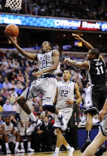 No. 12 Georgetown holds on to top Providence 49-40