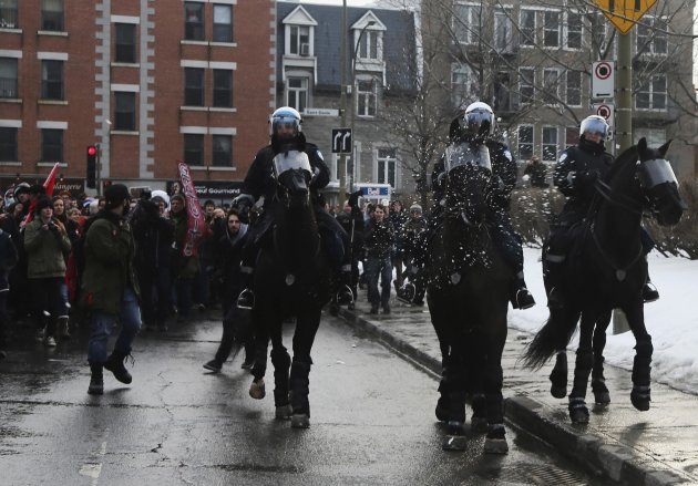 A snowball hits a policeman's horse during a demonstration following the Summit of Higher Education in Montreal