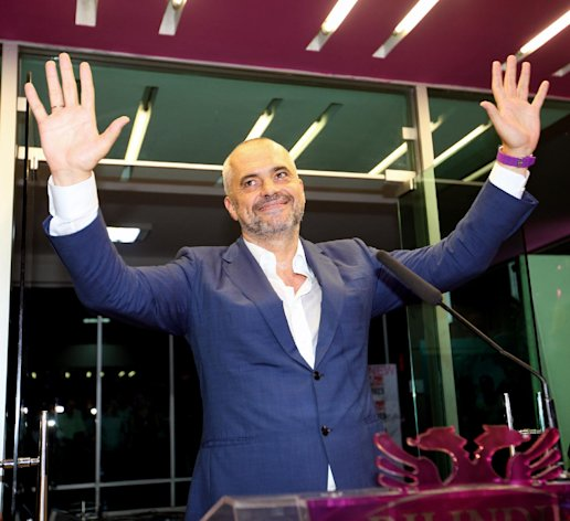 Opposition Socialist Party leader Edi Rama gestures as he gives his victory speech at party headquarters in Tirana calling on the governing Democratic Party of Prime Minister Sali Berisha to acknowledge its loss, after counting results show a clear lead of his party, Tuesday, June 25, 2013. Albania's national elections were seen as key test for the country's hopes for closer ties with the European Union. (AP Photo/Hektor Pustina)