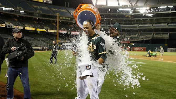 A's beat Mariners on Crisp's homer in 12th