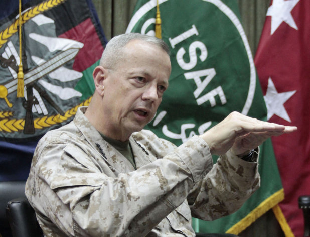 U.S. Gen. John Allen, top commander of the NATO-led International Security Assistance Forces (ISAF) and US forces in Afghanistan gestures during an interview with the Associated Press in Kabul, Afghanistan, Sunday, July 22, 2012. Gen. Allen says this year's pullout of 23,000 American troops is at the halfway point. He told The Associated Press in an interview Sunday that a significant number will leave in August and early September. (AP Photo/Musadeq Sadeq)
