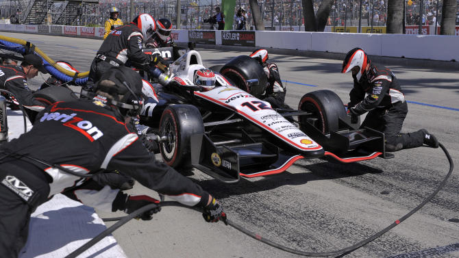 Will Power, of Australia, makes a pit stop during the IndyCar Series' Toyota Grand Prix of Long Beach auto race, Sunday, April 15, 2012, in Long Beach, Calif.  Power won the race. (AP Photo/Mark J. Terrill)