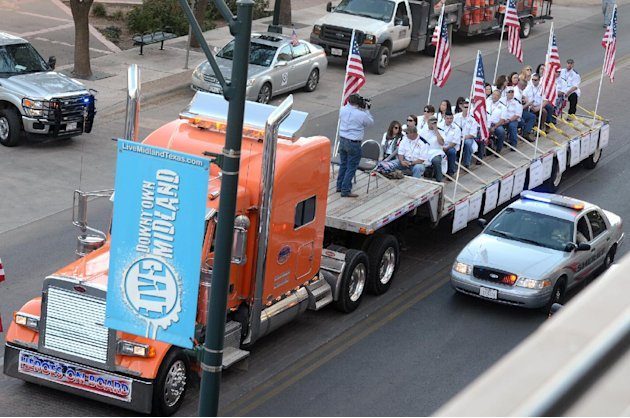 FILE - In this Nov. 15, 2012 file photo, a flatbed truck carries wounded veterans and their families during a parade before it was struck by a train in Midland, Texas. A 50-year-old Army veteran who s
