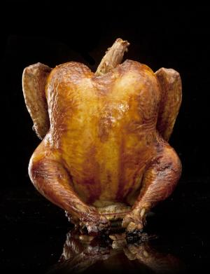 This undated image provided by Modernist Cuisine shows beer can chicken. (AP Photo/Modernist Cuisine)