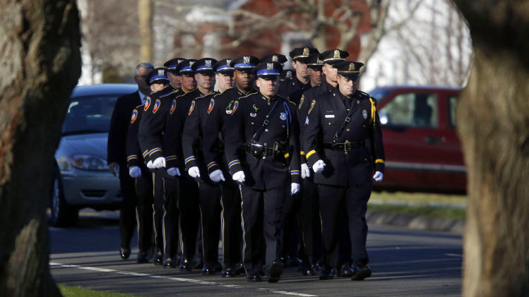 A police honor guard arrives for the funeral service of Victoria Soto at Lordship Community Church, Wednesday, Dec. 19, 2012, in Stratford, Conn. Soto was killed when a gunman forced his way into Sandy Hook Elementary School in Newtown Dec. 14 and opened fire, killing 26 people, including 20 children. (AP Photo/Jason DeCrow)