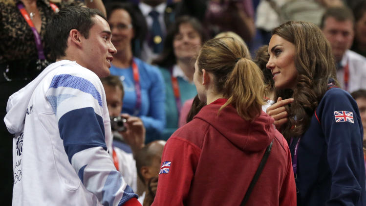 Kate, Duchess of Cambridge, right, speaks with Britain's gymnast Kristian Thomas, left, during the artistic gymnastics apparatus finals at the 2012 Summer Olympics, Sunday, Aug. 5, 2012, in London.  (AP Photo/Julie Jacobson)