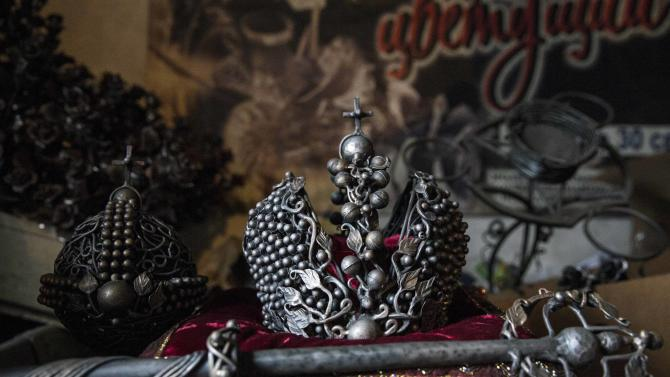 A metal crown made in the likeness of the Imperial Crown of Russia by local blacksmith Viktor Mikhalev is seen in his shop in Donetsk