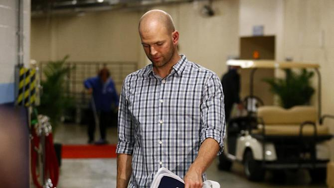 Toronto Blue Jays pitcher J.A. Happ walks into Tropicana Field following his release from the hospital earlier in the day Wednesday, May 8, 2013, in St. Petersburg, Fla. Happ was hit in the head by a line drive from Tampa Bay Rays' Desmond Jennings during a baseball game the night before.  He also injured his knee on the play. (AP Photo/Mike Carlson)