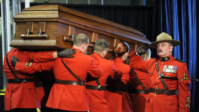 RCMP officer salutes the casket as it leaves the funeral services for RCMP Constable David Wynn in St. Albert, Alberta
