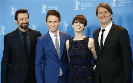 Actors Hugh Jackman, Eddie Redmayne, Anne Hathaway and director Tom Hooper (L-R) pose during a photocall to promote the movie &quot;Les Miserables&quot; at the 63rd Berlinale International Film Festival in Berlin February 9, 2013. REUTERS/Fabrizio Bensch