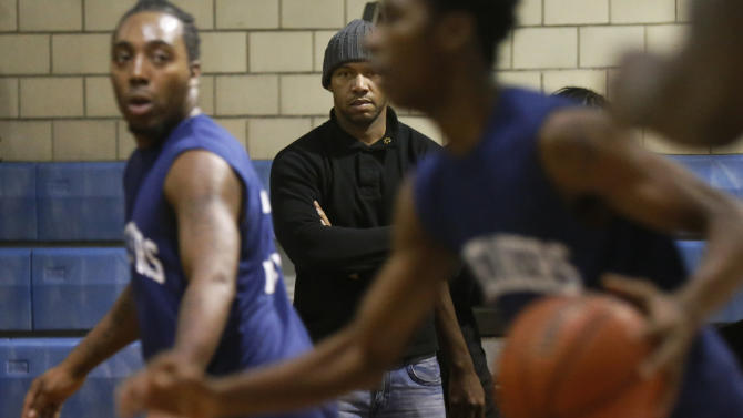 In this Monday, Dec. 17, 2012 photo, Curtis Toler watches his team participate in a basketball tournament for reputed gang members and associates at the St. Sabina Catholic Church in the Auburn-Gresham neighborhood on Chicago's South Side. Toler, 35, a former gang member and father of four, spent much of his life causing chaos. Now, he's preaching calm. As a supervisor at CeaseFire, his job is to ease tensions and defuse disputes before they explode. (AP Photo/Charles Rex Arbogast)