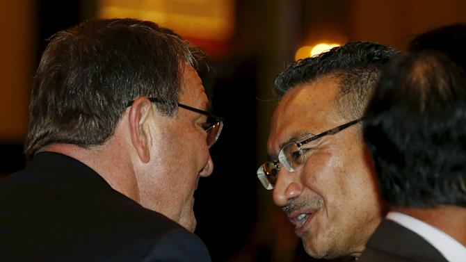 U.S. Secretary of Defence Ashton Carter speaks to Malaysia's Defence Minister Hishammuddin Hussein before the opening of the International Institute for Strategic Studies (IISS) Shangri-La Dialogue in Singapore