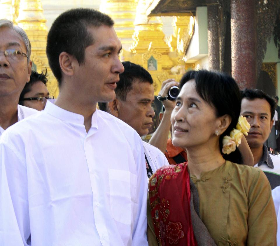 FILE - In this Wednesday, Nov. 24, 2010 file photo, Myanmar's pro-democracy icon Aung San Suu Kyi, right, and her son Kim Aris visit the Shwedagon Pagoda in Yangon, Myanmar. (AP Photo/Khin Maung Win)