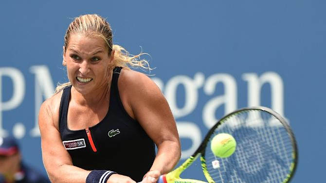 Dominika Cibulkova returns a shot against Ana Ivanovic during their US Open match on August 31, 2015 in New York
