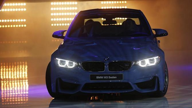 The BMW M3 sedan is rolled out during the press preview day of the North American International Auto Show in Detroit