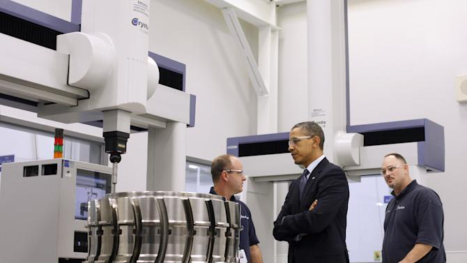 President Barack Obama, with employees Robert Abernathy, left, and Steven C. Morris, right, tours the Rolls-Royce Crosspointe jet engine disc manufacturing facility, Friday, March, 9, 2012, in Prince George, Va. Crosspoint facility manufactures precision-engineered engine disc and other components for aircrafts. (AP Photo/Pablo Martinez Monsivais)