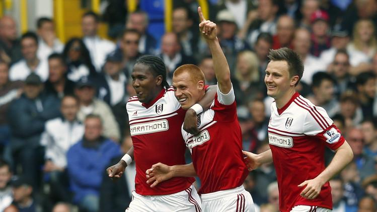 Fulham's Sidwell celebrates with teammates Kvist and Rodallega after scoring goal against Tottenham Hotspur during their English Premier League soccer match at White Hart Lane in London