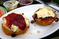 Is it scone to rhyme with John, or scone to rhyme with Joan? And while we're at it is it jam or cream on first? We want to know