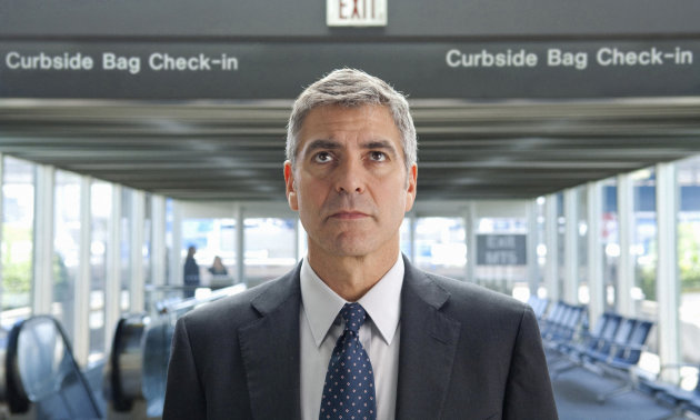 "FILE - In this undated film publicity image released by Paramount, George Clooney portrays Ryan Bingham in a scene from ""Up in the Air."" (AP Photo/Paramount Pictures, Dale Robinette, File)"