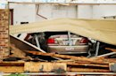 A car is seen in a damaged home after Wednesday&#039;s tornado in Cleburne, Texas on Thursday, May 16, 2013. Ten tornadoes touched down in several small communities in Texas overnight, leaving at least six people dead, dozens injured and hundreds homeless. Emergency responders were still searching for missing people Thursday afternoon. (AP Photo/Ron Russek II)