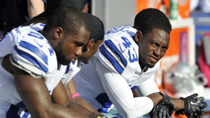 Dallas Cowboys safety Gerald Sensabaugh (43) looks on from the sideline in the second half of an NFL football game against the Baltimore Ravens in Baltimore, Sunday, Oct. 14, 2012. Baltimore won 31-29. (AP Photo/Gail Burton)