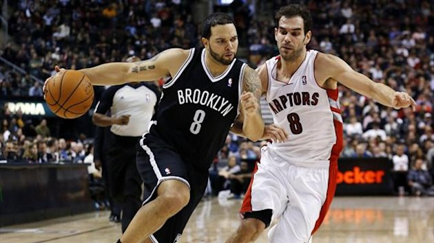 Brooklyn Nets Deron Williams drives to the net past Toronto Raptors Jose Calderon (Reuters)