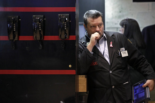 Trader Jason Harper works on the floor of the New York Stock Exchange Friday, June 22, 2012. Stocks are bouncing back in early trading, a day after suffering their second-worst loss this year. The unlikely leaders: banks. (AP Photo/Richard Drew)