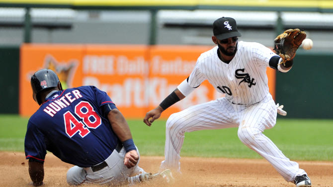 Minnesota Twins'  Torii Hunter (48) is safe at second base as Chicago White Sox shortstop Alexei Ramirez (10) takes the throw during the fourth inning of a baseball game, Sunday, May 24, 2015, in Chicago. (AP Photo/David Banks)