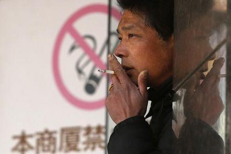 Amended China law curbs tobacco ads in land of smokers
