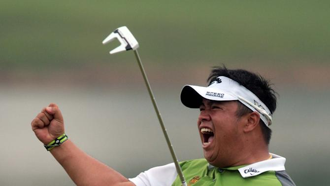Kiradech Aphibarnrat of Thailand celebrates winning the inaugural Shenzhen International golf tournament at Genzon Golf Club in Shenzhen in southern China's Guangdong Province, Sunday, April 19, 2015. Aphibarnrat won the tournament after an eagle on the 17th hole and beating Chinese teenager Li Haotong in a playoff. (Chinatopix Via AP) CHINA OUT