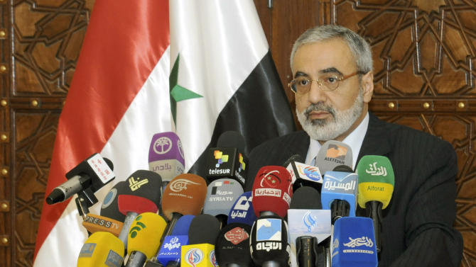 """In this photo released by the Syrian official news agency SANA, Syrian Information Minister Omran al-Zoubi speaks during a press conference in Damascus, Syria, Sunday, May. 5, 2013. Al-Zoubi says the Israeli attack is evidence of the Jewish state's links with Islamic extremist groups trying to overthrow President Bashar Assad's regime. He added that Syria has the right and the duty """"to defend its people by all available means."""" (AP Photo/SANA)"""
