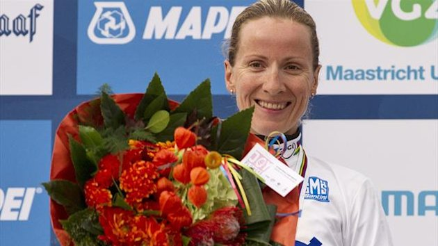 Judith Arndt of Germany celebrates on the podium after winning the women's elite time trial at the UCI Road World Championships