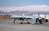 US Predator unmanned drone armed with a missile setting off from its hangar at Bagram air base in Afghanistan in 2009. A US drone strike on Monday killed at least five Islamic militants in Pakistan's restive tribal region near the Afghan border, security officials said