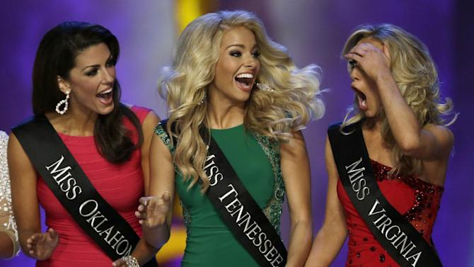 Miss Virginia Courtney Paige Garrett, right, gasps after she is announced as a finalist during the Miss America 2015 pageant, Sunday, Sept. 14, 2014, in Atlantic City, N.J. Garrett took first runner up honors while Miss New York Kira Kazantsev won the crown. Looking on are Miss Oklahoma Alex Eppler, left, and Miss Tennessee Hayley Lewis. (AP Photo/Julio Cortez)