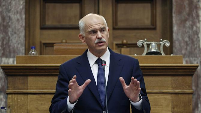 Greek Prime Minister George Papandreou addresses Socialist lawmaker members of parliament in Athens, in Athens, on Thursday, Nov. 3, 2011. Greece's embattled prime minister says he has invited opposition conservatives to join talks on a major European debt deal, ignoring calls to hold an early general election. Papandreou on Thursday insisted he never would have put the question of whether Greece stays in the joint euro currency to a popular vote.(AP Photo/Petros Giannakouris)