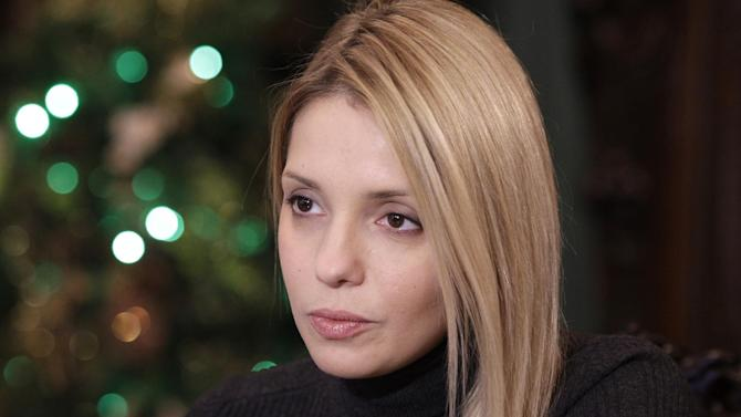 Eugenia Tymoshenko, daughter of jailed former Ukrainian Prime Minister Yulia Tymoshenko speaks during an interview with The Associated Press in Kiev, Ukraine, Thursday, Dec. 27, 2012. Eugenia Tymoshenko is calling on Western nations to impose sanctions on Ukrainian officials involved in her mother's case. Tymoshenko's imprisonment has strained Ukraine's ties with the West. The European Union suspended a key cooperation deal with Kiev over her case. (AP Photo/Sergei Chuzavkov)