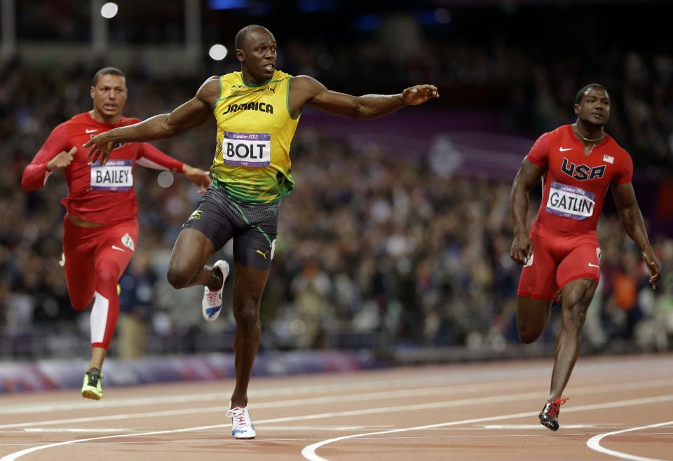 Jamaica's Usain Bolt, center, leads United State's Ryan Bailey, left, and United States' Justin Gatlin, right, in the men's 100-meter final during the athletics in the Olympic Stadium at the 2012 Summer Olympics, London, Sunday, Aug. 5, 2012.(AP Photo/Anja Niedringhaus)