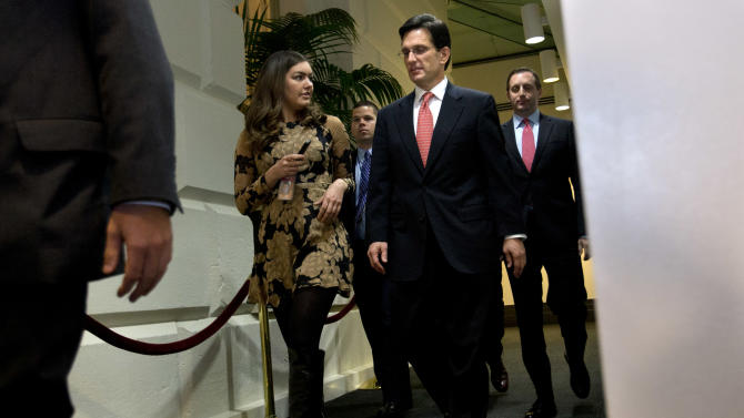 "House Majority Leader Eric Cantor, R-Va., center, leaves a second Republican caucus meeting to discuss the ""fiscal cliff"" bill passed by the Senate Monday night_and now awaits a vote in the GOP-controlled House_ at the Capitol in Washington on Tuesday, Jan. 1, 2013. (AP Photo/Jacquelyn Martin)"