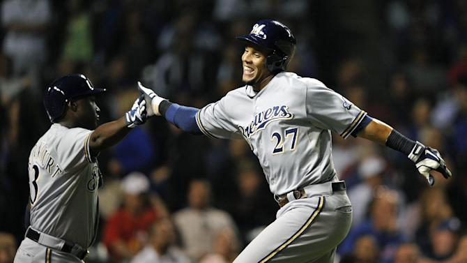 Brewers score 5 in 9th to end Cubs' 3-game streak