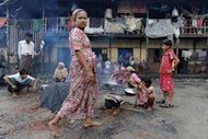 Muslim Rohingyas cook in the courtyard of a school sheltering Internally Displaced Persons in the village of Theik Kayk Pyim, located on the outskirts of Sittwe, capital of Myanmar's western Rakhine state. Despite their decades-long presence, Myanmar views the roughly 800,000 Rohingya as illegal immigrants from Bangladesh, and denies them citizenship