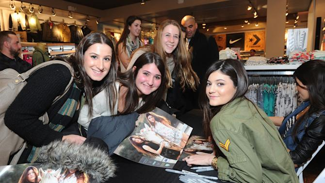 Kylie, second right, and Kendall Jenner meet with fans during a public appearance to launch their exclusive Kendall & Kylie collection at PacSun, Friday, February 8, 2013, on Long Island, New York.   (Photo by Diane Bondareff/Invision for PacSun/AP Images)