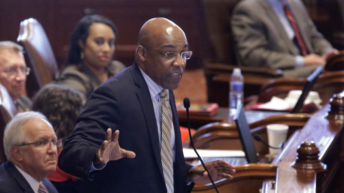 Illinois Sen. Kwame Raoul, D-Chicago, argues concealed carry gun legislation while on the Senate floor during session at the Illinois State Capitol Tuesday, July 9, 2013, in Springfield, Ill. Illinois became the last state in the nation to allow public possession of concealed guns as lawmakers rushed Tuesday to finalize a proposal ahead of a federal court's deadline. (AP Photo/Seth Perlman)
