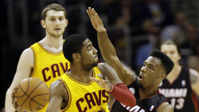 Cleveland Cavaliers' Kyrie Irving, left, is defended by Miami Heat's Norris Cole in the first quarter of an NBA basketball game Monday, April 15, 2013, in Cleveland. (AP Photo/Mark Duncan)