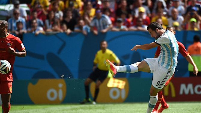 Argentina's Gonzalo Higuain scores his team's first goal during their quarter-final match against Belgium at the Mane Garrincha National Stadium in Brasilia during the 2014 FIFA World Cup on July 5, 2014