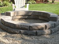The firepit, almost finished. Just need to add one more course of blocks.