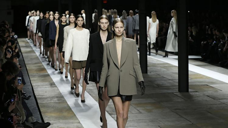 Models parade at the conclusion of the Theyskens Theory Fall 2013 runway show at Fashion Week in New York, Monday, Feb. 11, 2013.  (AP Photo/Kathy Willens)